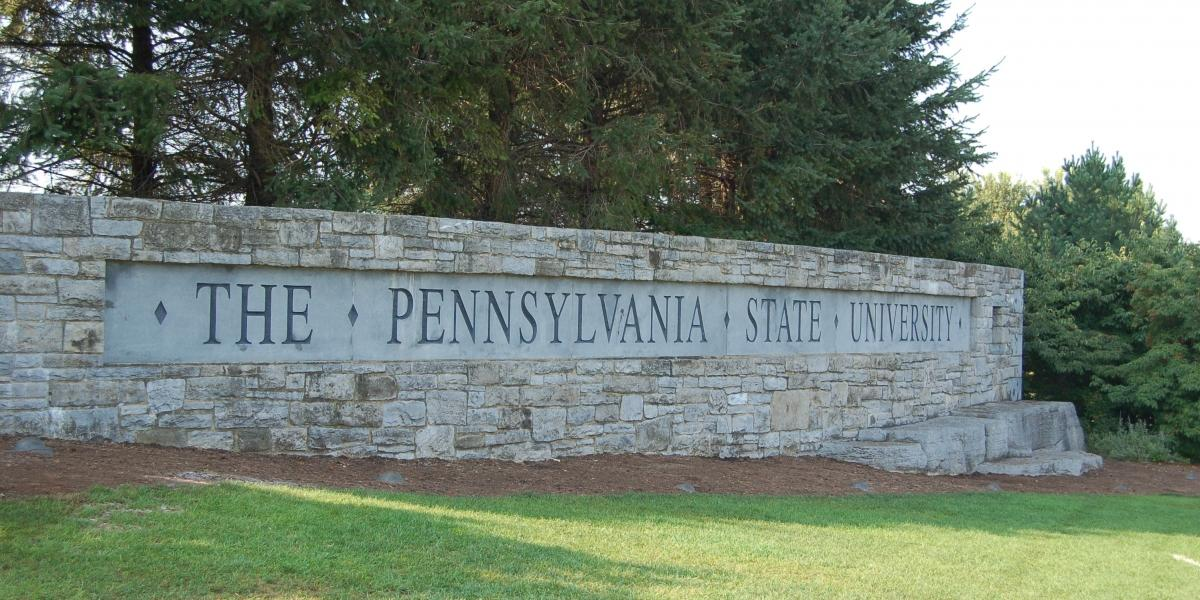 Stone sign with The Pennsylvania State University carved in it